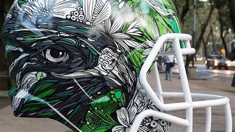 New designs for every NFL helmet via Mexican artists